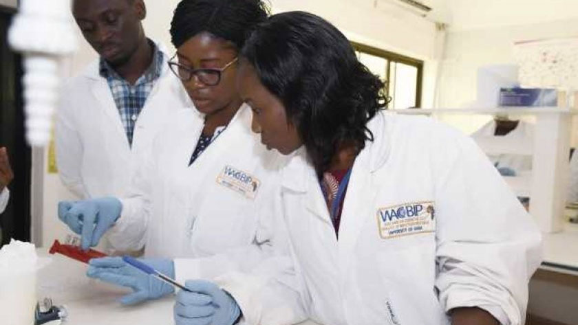 Three young scientists at one of the laboratories at the West African Centre for Cell Biology of Infectious Pathogens (WACCBIP), University of Ghana, Accra. ©