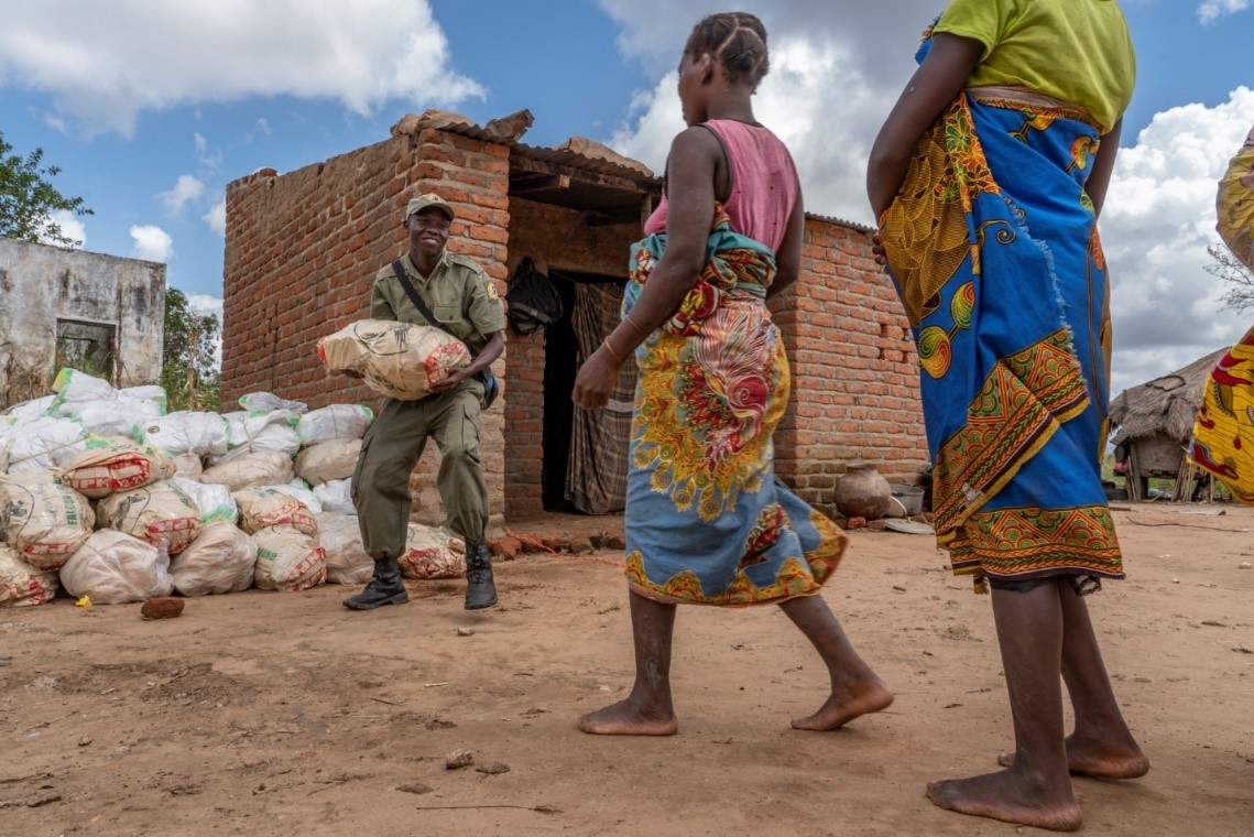 Gorongosa Park rangers distribute emergency food rations in the days after Cyclone Idai in March 2019.