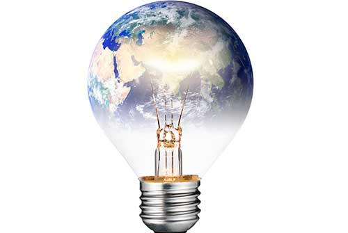Switched ON Lightbulb in the Shape of the World - Shutterstock l tr3gin