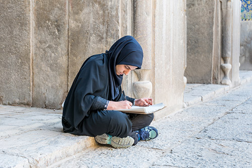 Victor Jiang | Shutterstock.com - A university student in Naqsh-e Jahan Square