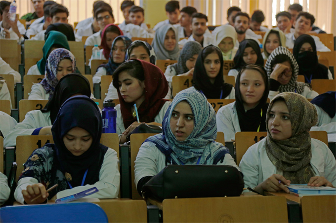 Afghan students attending their class in Kabul University