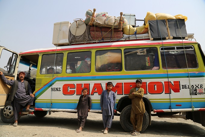 A bus with returnees from Pakistan at the IOM Screening center on Turkham border in Nangarhar province