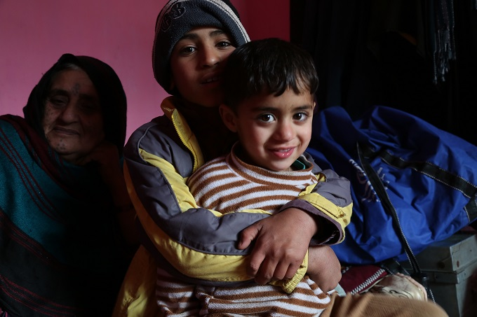 Shakib, 10, is hugging his younger brother Mahmood, 5, during an IOM home visit in Kabul to assess the situation of Afghan returnees from Pakistan