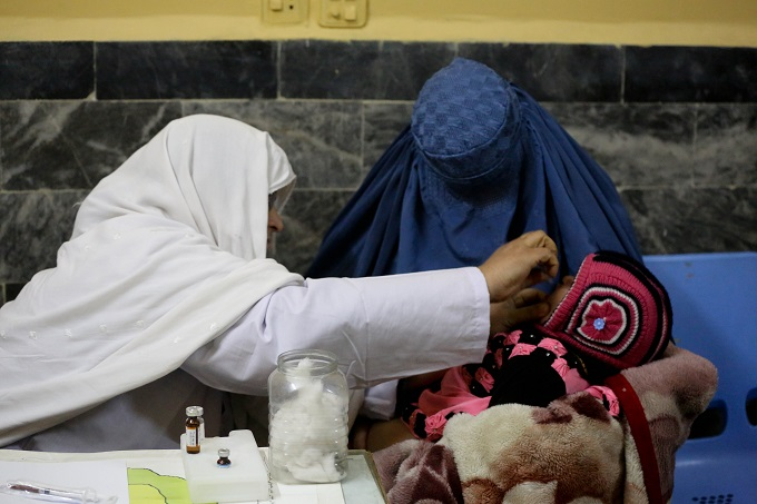 A local woman has brought her eight-month-old son to the Baidari Hospital in eastern Jalalabad city for vaccination.