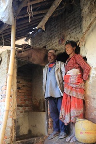 Chaturman and Nyuchemaya outside the new toilet on their back porch
