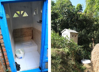 A new toilet in Nangkhel village, with tiles, mirror and showerhead—next to a house without electricity