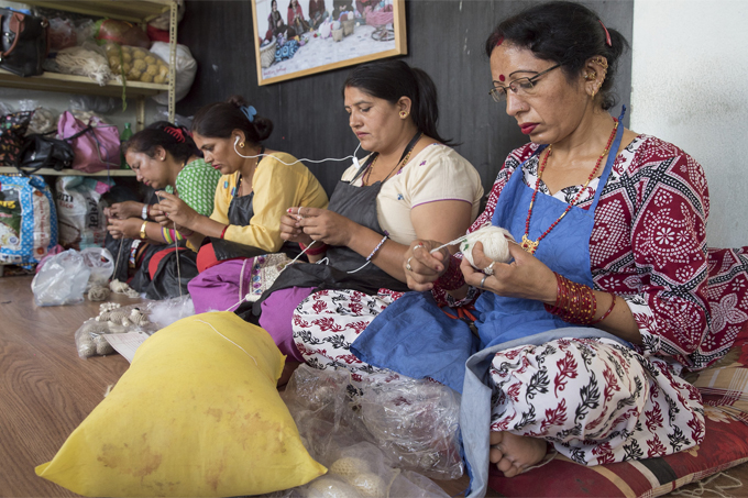 Women knit handicrafts for export at Everest Fashion Fair Craft in Lalitpur, Nepal