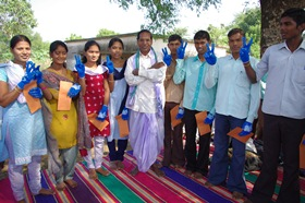 Village head with high school students receiving scholarship, Golamunda village in Orissa, 2010