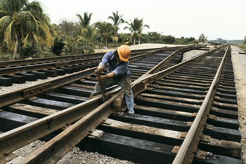 Man fixing railroad tracks, Mexico. Photo credit: Curt Carnemark / World Bank
