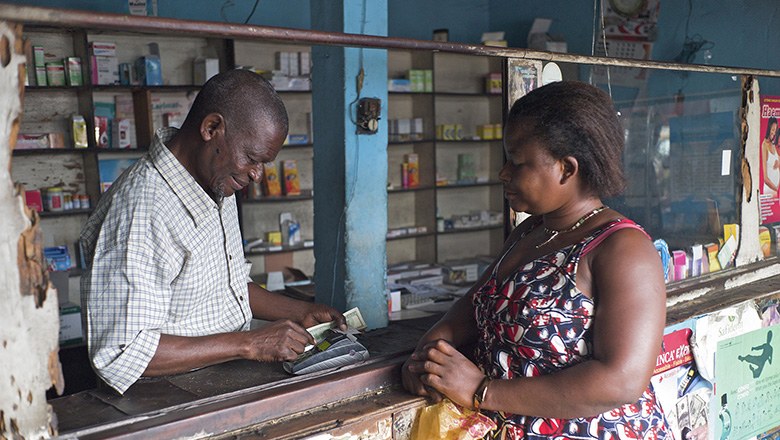 A digital transaction in the Democratic Republic of Congo. Such transactions are made possible in part by FINCA. FINCA's strategy in Africa is to focus operations on underserved markets and groups, namely rural areas and women. Photo: Anna Koblanck/IFC