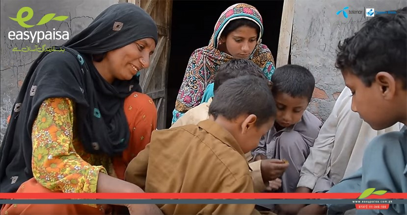 Easypaisa Pakistan Health Insurance Blog - Family Eating (from a Telenor Pakistan promotional video for Easypaisa)