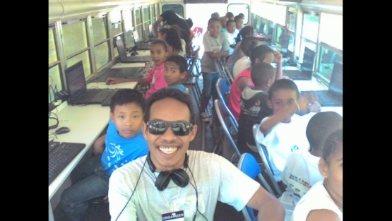 Malagasy children learning coding basics on the CoderBus, a mobile computer lab that brings computer science to children throughout the country.