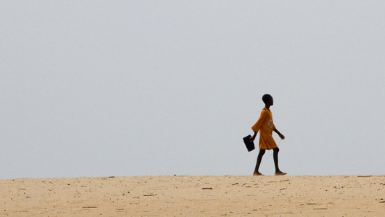 Young girl walks to school