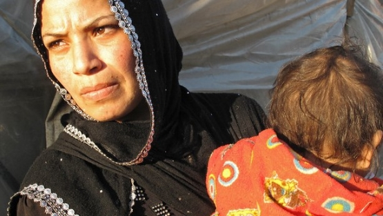 Sabah and her young child in Al Minieh Informal Tented Settlement, North Lebanon.