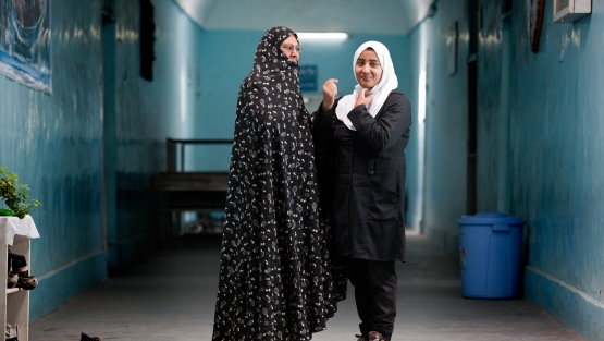Shkeba and her daughter Sohaila who attends the Female Experimental High School in  Herat, Afghanistan. Photo: © Graham Crouch/World Bank