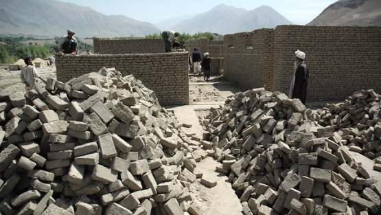 Workers build the Shash Pul school project in Afghanistan