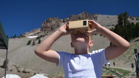 A young visitor tours the Lassen Peak summit with VR goggles. (Photo: LassenNPS / Flickr CC)