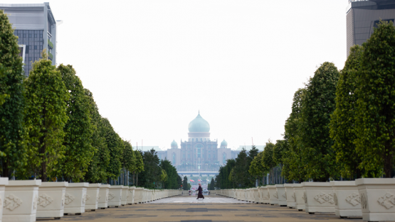 A woman walks in Putrajaya, the federal administrative center of Malaysia. As the country gears up to work on its 12th Malaysia Plan, its rich experience in national development planning for the past 60 years provides key lessons to consider.