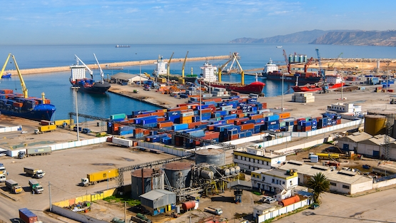 Shipping crates are loaded onto boats at the Port of Oran, a coastal city of Algeria.