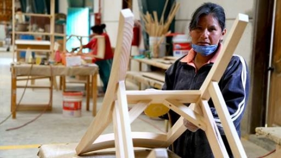 Image: Women working in a woodshop in Oaxaca, Mexico.
