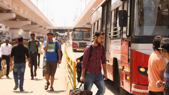 Commuters walk in and out of a Bus Rapid Transit station in Pune, India. Photo: Nittin Warrier/Flickr.