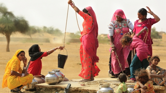Women in Jaisalmer India draw water from the well