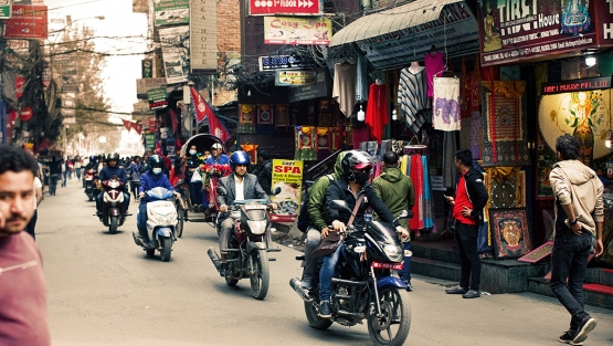 Two-wheelers and pedestrians in Kathmandu, Nepal.