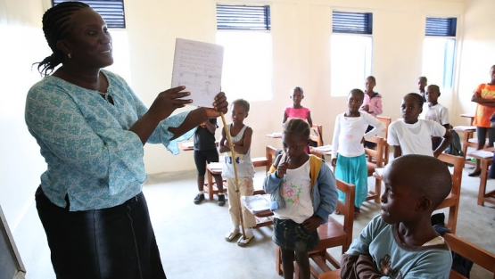 A teacher talks to her students during class at Billy Town Public School in Billy Town, Liberia after the threat of Ebola outbreak diminishes on March 5, 2015. (Photo: Dominic Chavez/World Bank)
