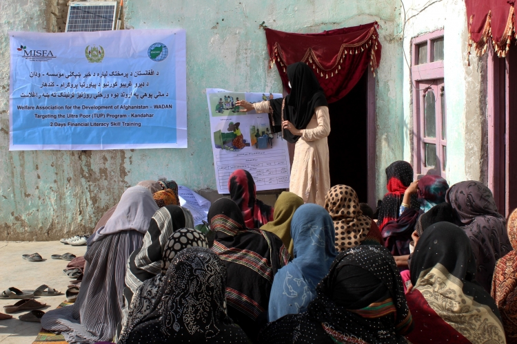 A group of women in Kandahar attend a financial literacy class to learn about the importance of saving and how to access local financial institutions. Photo: © Microfinance Investment Support Facility for Afghanistan