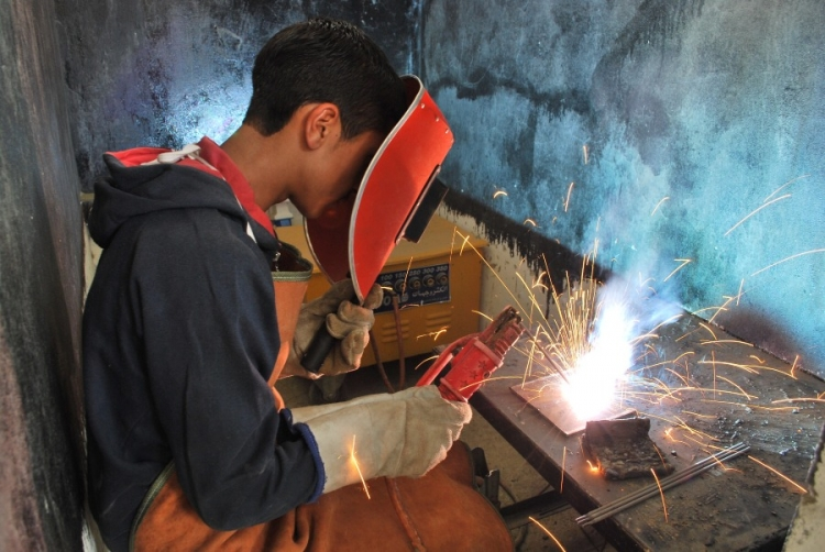 A student does arc welding. Afghanistan