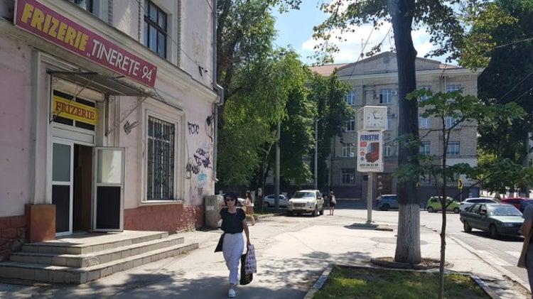 A lady walking in the street of Chisinau, Moldova
