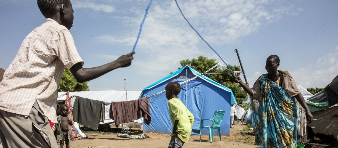 Displaced children residing at a United Nations transit site in South Sudan take time to play. © UN Photo/Isaac Billy
