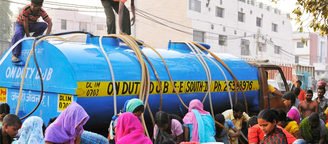 An acute shortage of piped water supply has led to dependence on water tankers at this locality in Delhi, India.