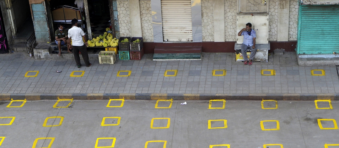 Positions are marked for maintaining physical distance at a market in Mumbai, India. Photo: Rajanish Kakade/​AP/​Shutterstock