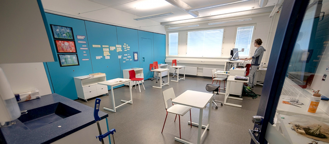 A teacher in Finland prepares his classroom for socially-distant learning.