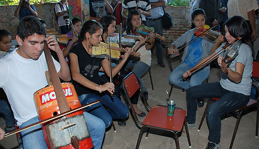The young musicians in this orchestra from Paraguay built their instruments from recycled materials (photo courtesy of the U.S. Embassy in Paraguay used through a Creative Commons license.)