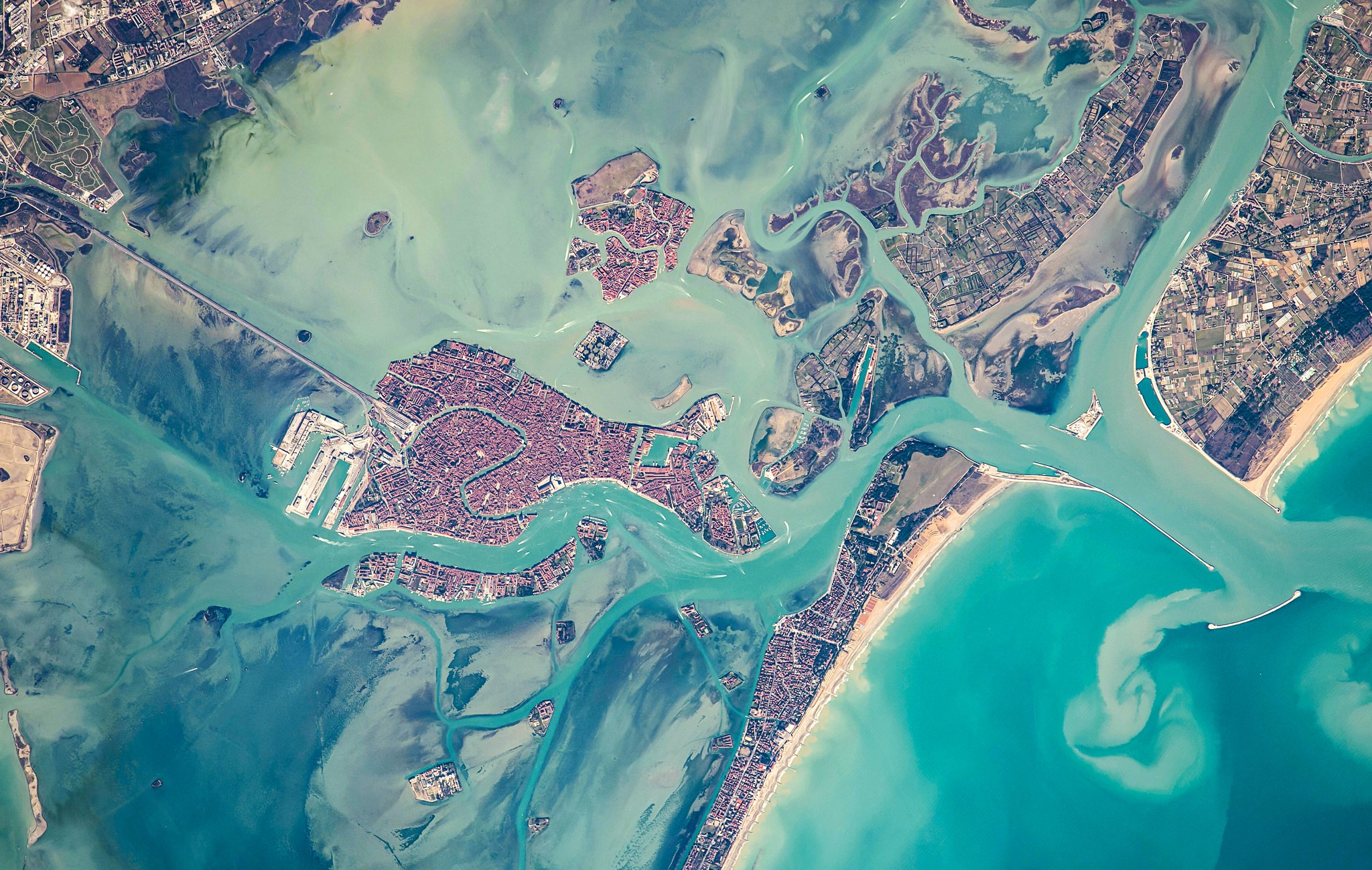 A satellite view of Venice and the surrounding lagoon. Upon completion of the MOSE project in 2018, a series of flood gates between the lagoon and the Adriatic Sea will protect the city from high tide and storm surges.