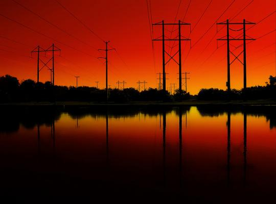 Power lines strecth over water. Source - DCCXLIX