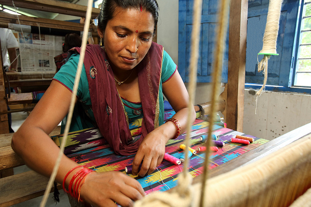 A Nepali woman weaving a shawl