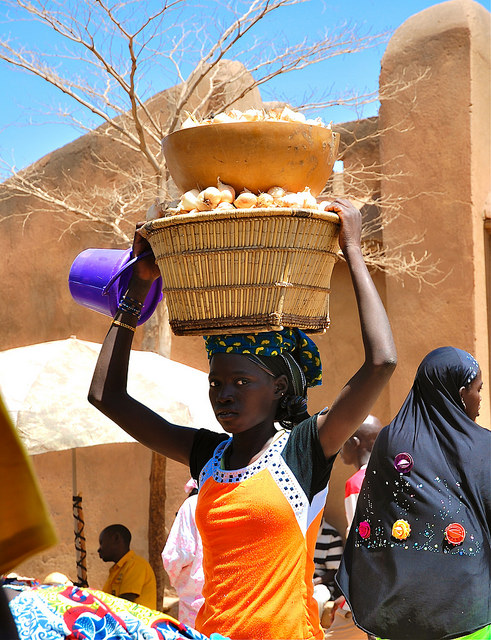 A woman brings onions to market in Mali. Photo - Irina Mosel / ODI via Flickr Creative Commons