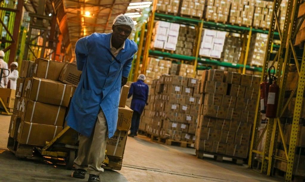 A worker transports medical supplies across a warehouse in Kenya. Photo: Sarah Farhat/World Bank