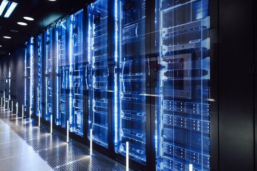 Data center in server room; katjen/Shutterstock.com