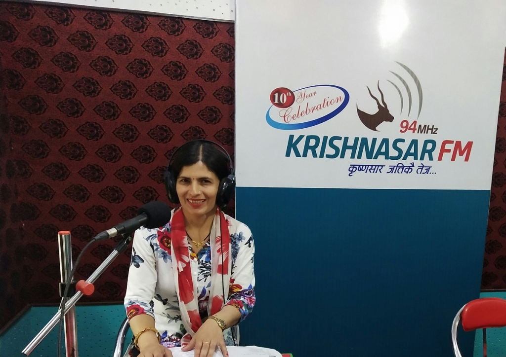 Shanti Kandel smiles as she delivers lessons from a local FM station.