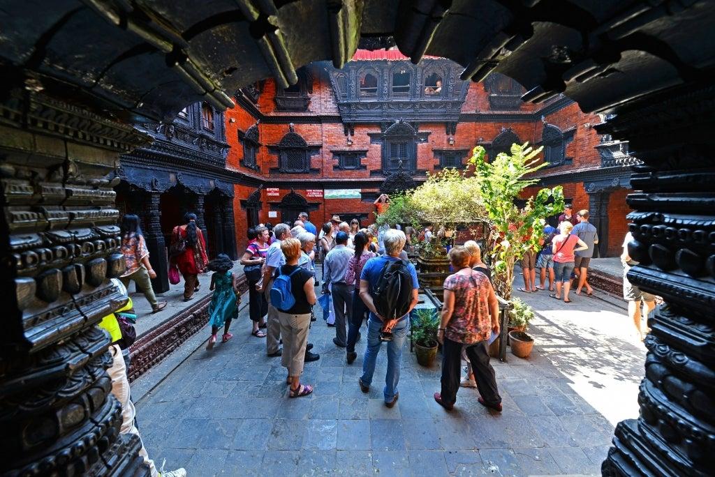 Tourists visiting the inner courtyard of the living Goddess Kumari in Kathmandu, Nepal, 2013. Photo: salajean / Shutterstock.com