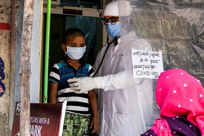 A doctor treats a patient in Mumbai, India - April, 2020. Photo: Akella Srinivas Ramalingaswami / Shutterstock.com