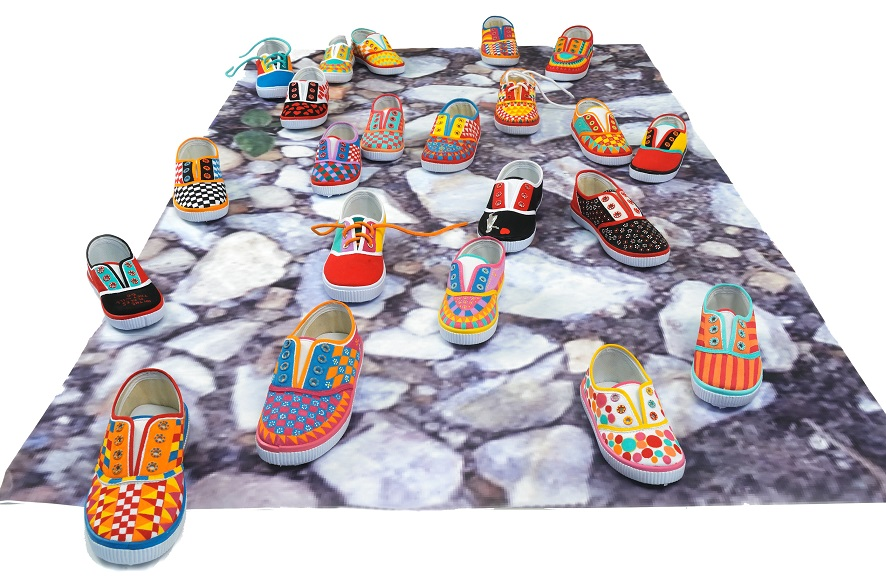 Helen Zughaib, The Places They Will Go, 2015-2016, dimensions variable, individual children's shoes, painted in acrylic gouache on adhesive photo installation. © Helen Zughaib