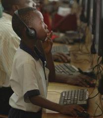 A boy works at a computer center in Accra, Ghana. © Jonathan Ernst/World Bank