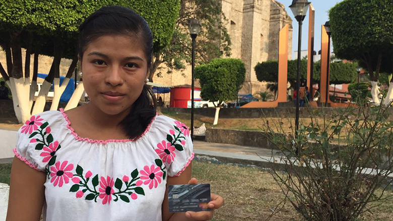 A girl with a bankcard in Mexico. Photo: Alberto Canche/ World Bank