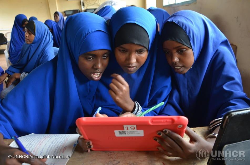 Girl students using tablets pre-loaded with educational software at their Instant Network Schools (INS) classroom in Juba primary school, Dadaab. © Assadullah Nasrullah/UNHCR