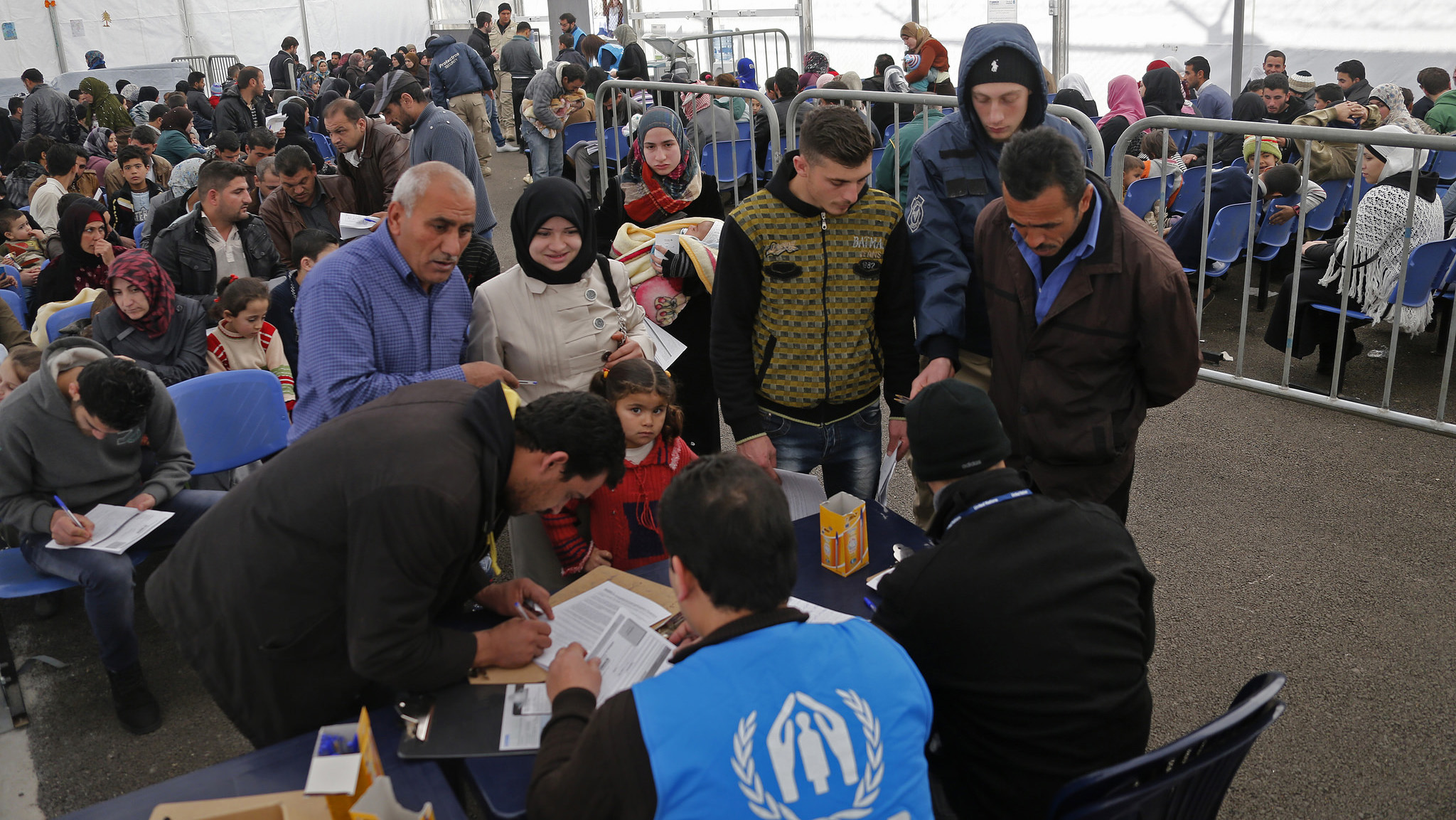 A family submitting an application at the UNHCR registration center in Tripoli, Lebanon. © Mohamed Azakir/World Bank